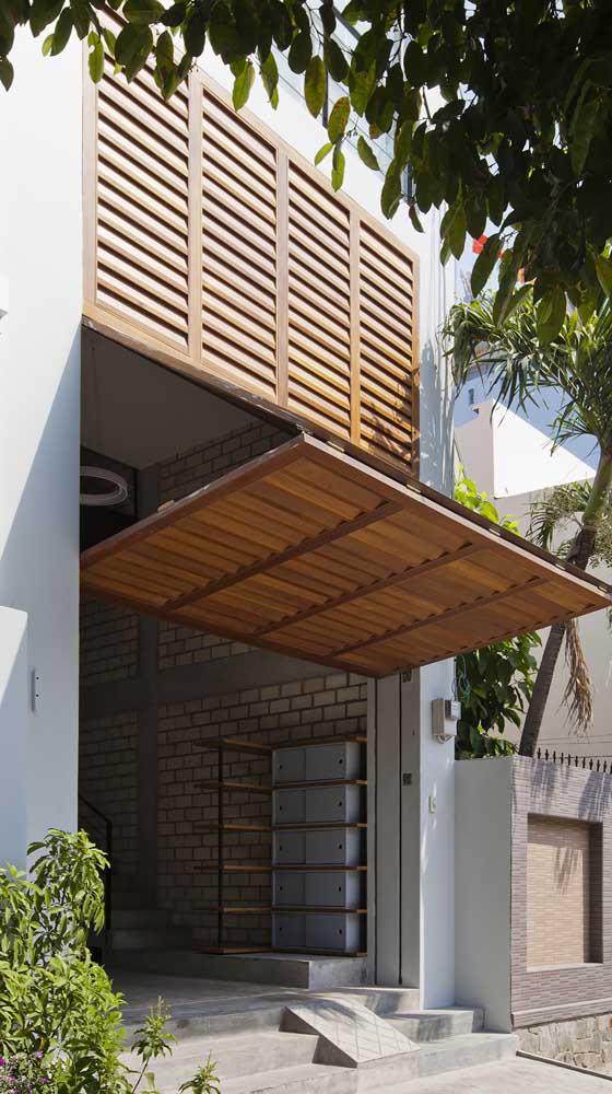 Portão basculante dobrável de madeira: um modelo para qualquer tipo de construção