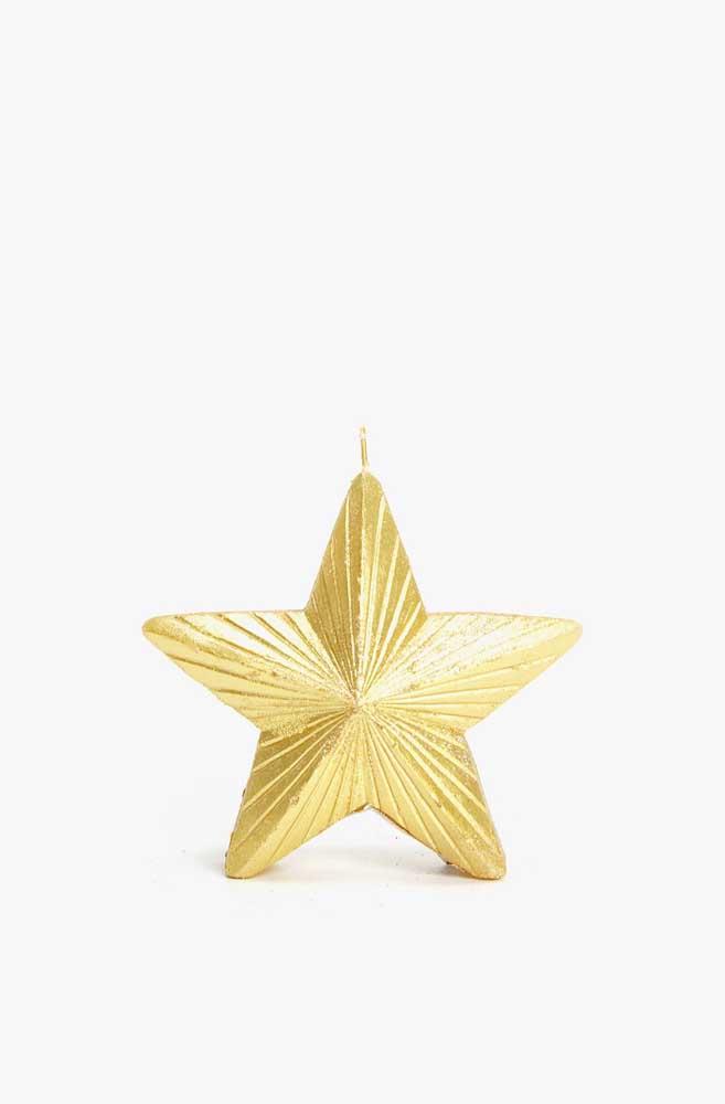 Uma das maiores protagonistas do natal, a estrela, aparece aqui na versão em vela