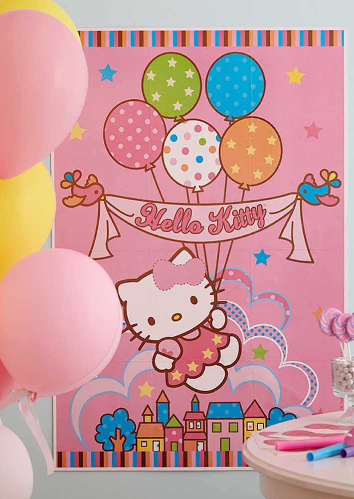 Para decorar a festa coloque um painel com a imagem da Hello Kitty.