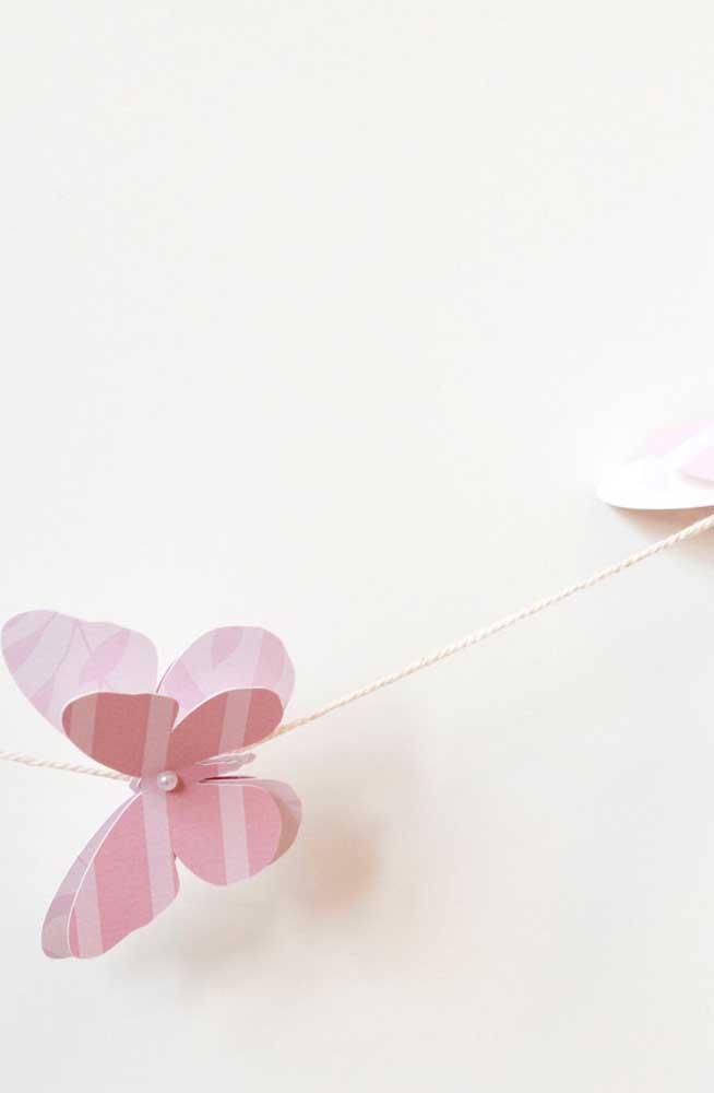Uma pérola para realçar a beleza delicada da borboleta de papel