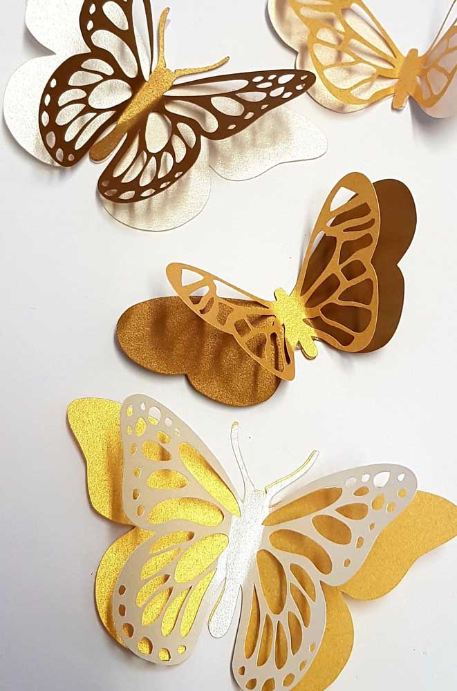 Que tal abrilhantar um pouco suas borboletas de papel? Para isso, use papel metalizado