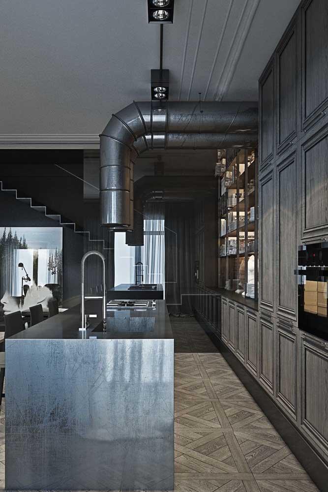 Cozinha americana em estilo industrial. As cores escuras prevalecem