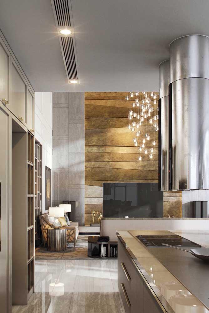 Sala de estar e cozinha integradas nessa penthouse moderna