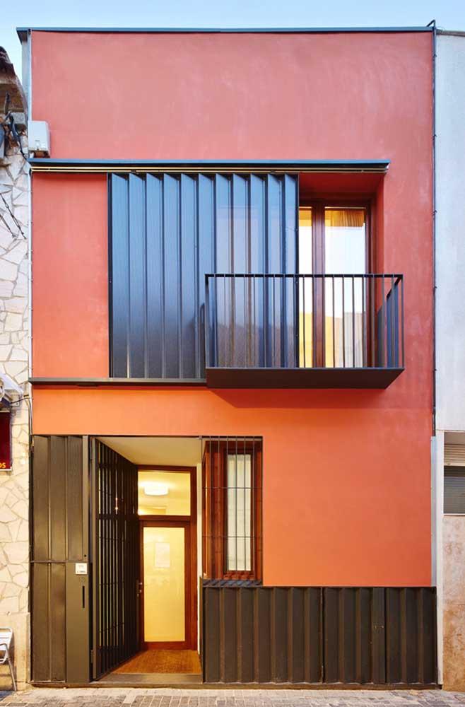 Casa laranja com detalhes em aço preto, gostou da proposta?
