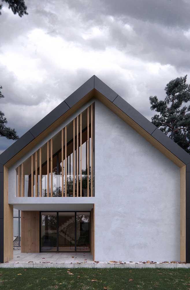 Fachada clean e moderna pintada em tons de cinza e complementada com madeira