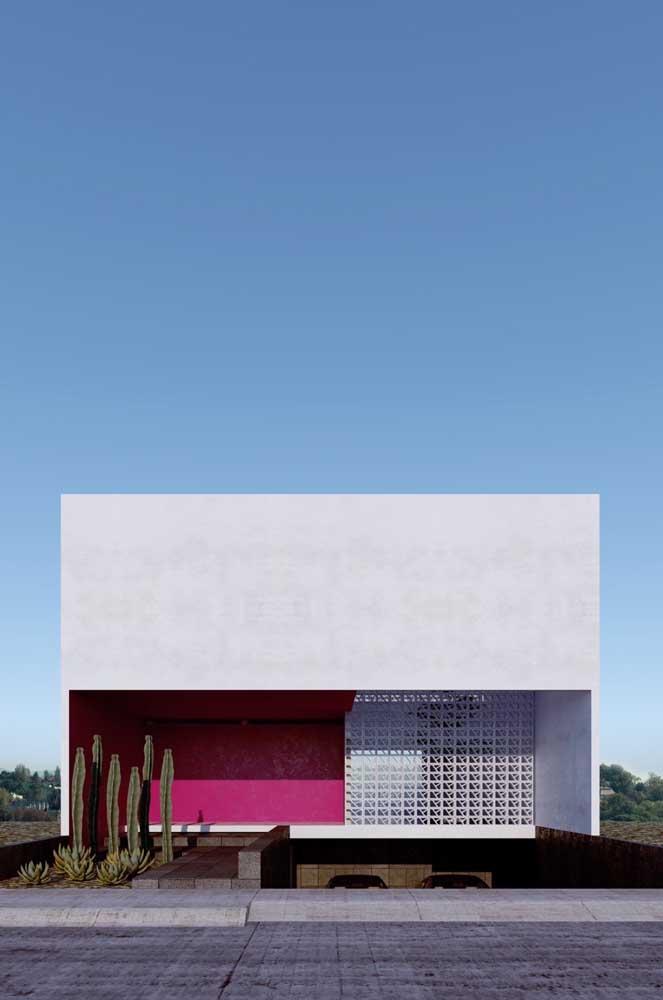 O rosa garante o destaque necessário para essa casa moderna