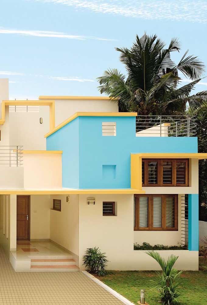 A casa de tons neutros ganhou apenas um ponto de cor azul para gerar destaque