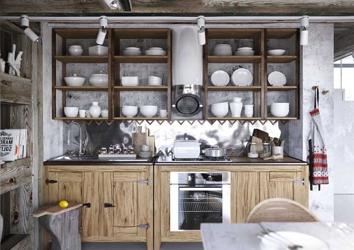 Móveis rústicos combinados a peças de inox. Uma combinação e tanto para a cozinha de estilo provençal