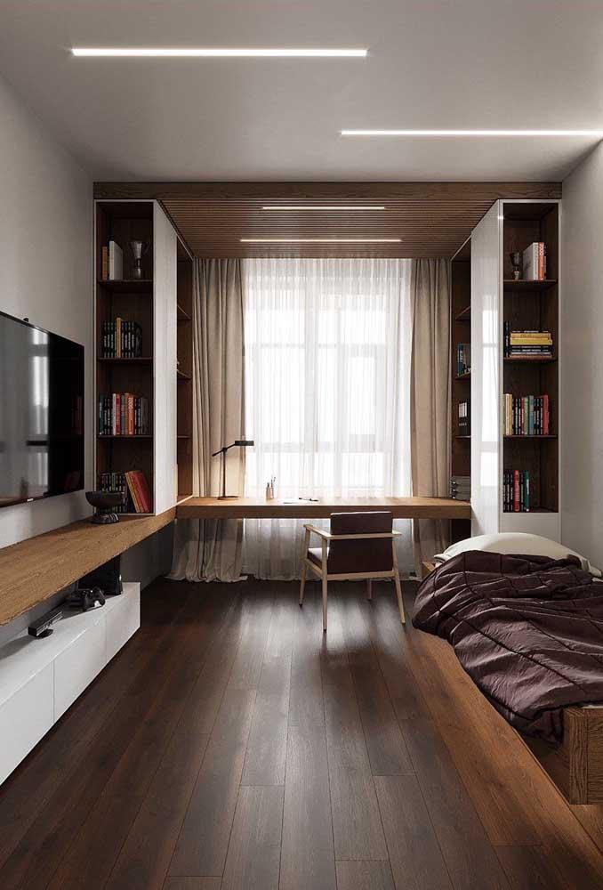 Quarto de solteiro planejado. Repare que aqui os móveis foram dispostos juntos à parede, liberando a área central do ambiente