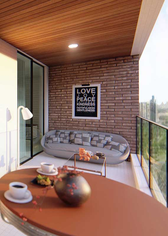 Já aqui, o formato oval do sofá traz modernidade para a varanda