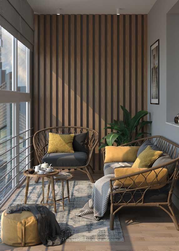Aqui, a varanda moderna apostou em um conjunto de sofá e poltronas de fibra natural
