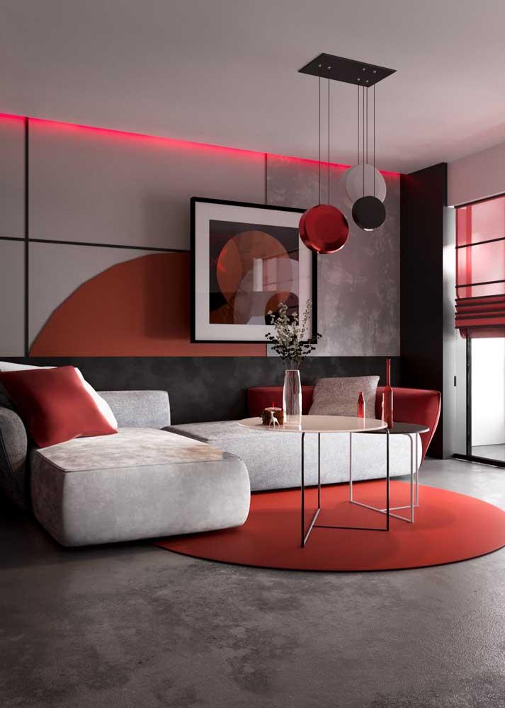 Decoração de sala vermelha em estilo contemporâneo. Aqui, o tom de cinza neutraliza o vermelho