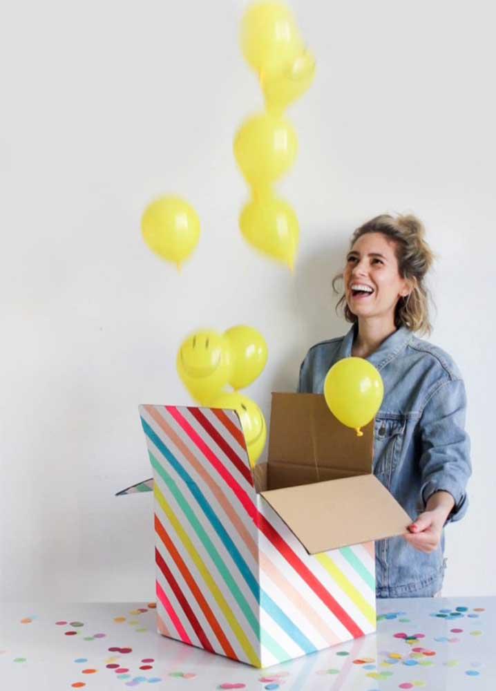 A surpresa aqui são os balões saindo de dentro da caixa