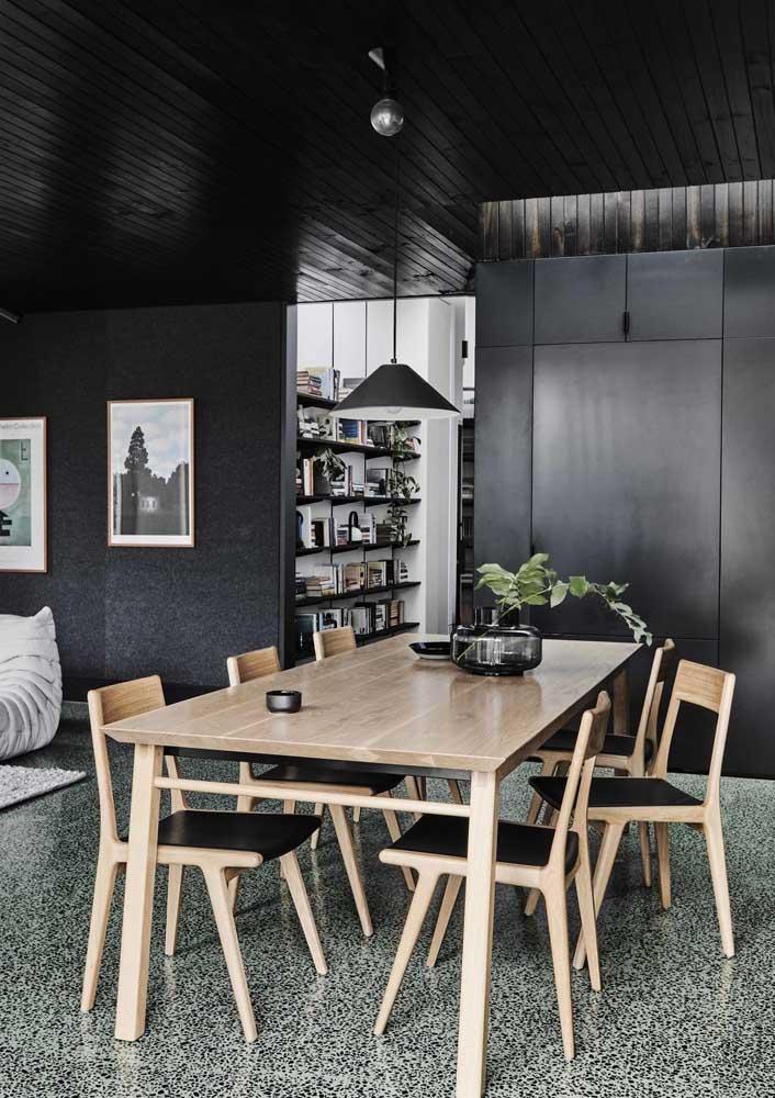 Piso de granilite em tom de verde e preto para a sala de estar integrada