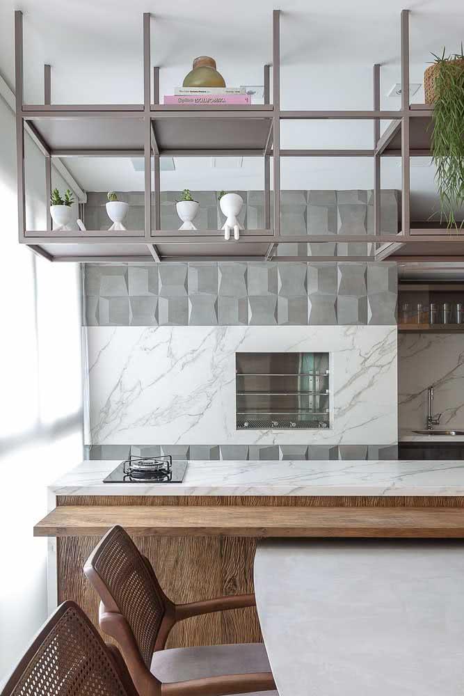 Os modelos embutidos de churrasqueira conferem um visual mais clean para as varandas de apartamento