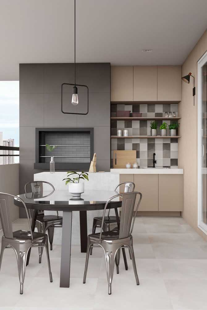 Varanda de apartamento moderna com churrasqueira embutida