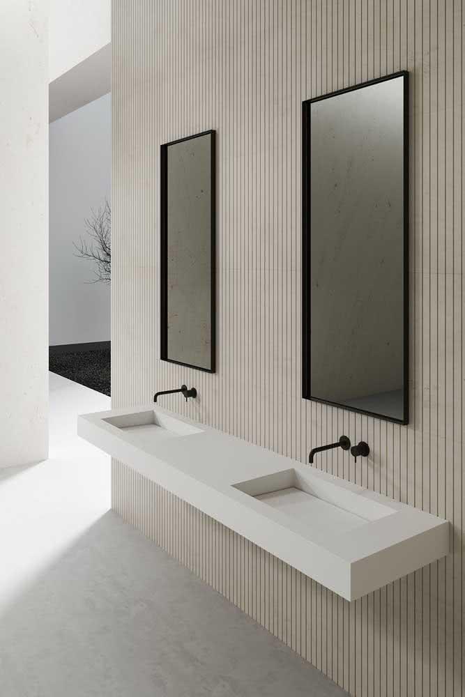Pia de porcelanato esculpida para o banheiro minimalista