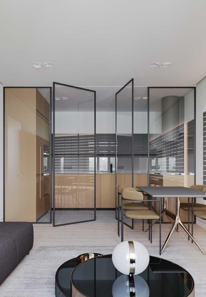 Os ambientes integrados deixam a cozinha como um plano de fundo clean e moderno a sala de estar!