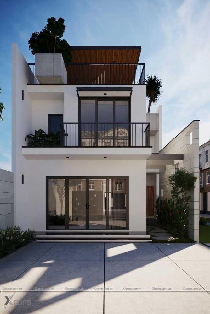 Esta residência optou por valorizar bem as áreas externas.