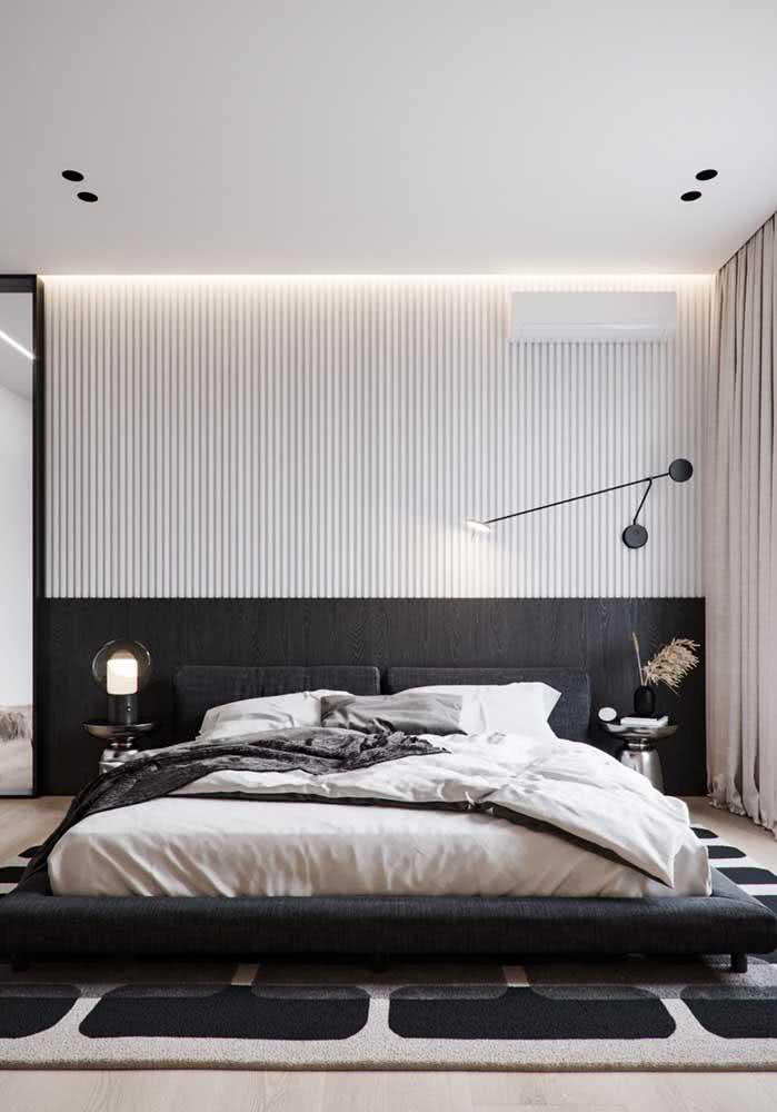 Decoração de quarto de casal preto e branco.