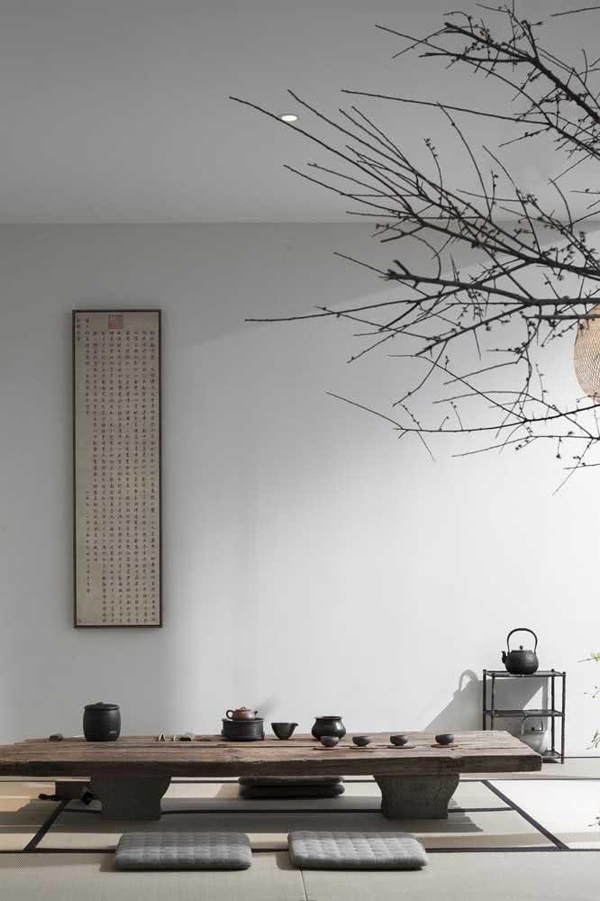 Sala de jantar japonesa: mesa baixa e futons no lugar das cadeiras