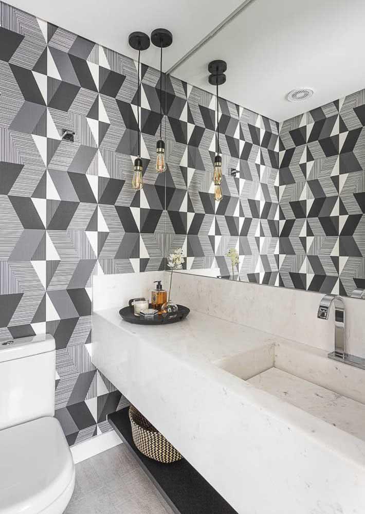 O papel de parede trouxe o cinza que o lavabo precisava