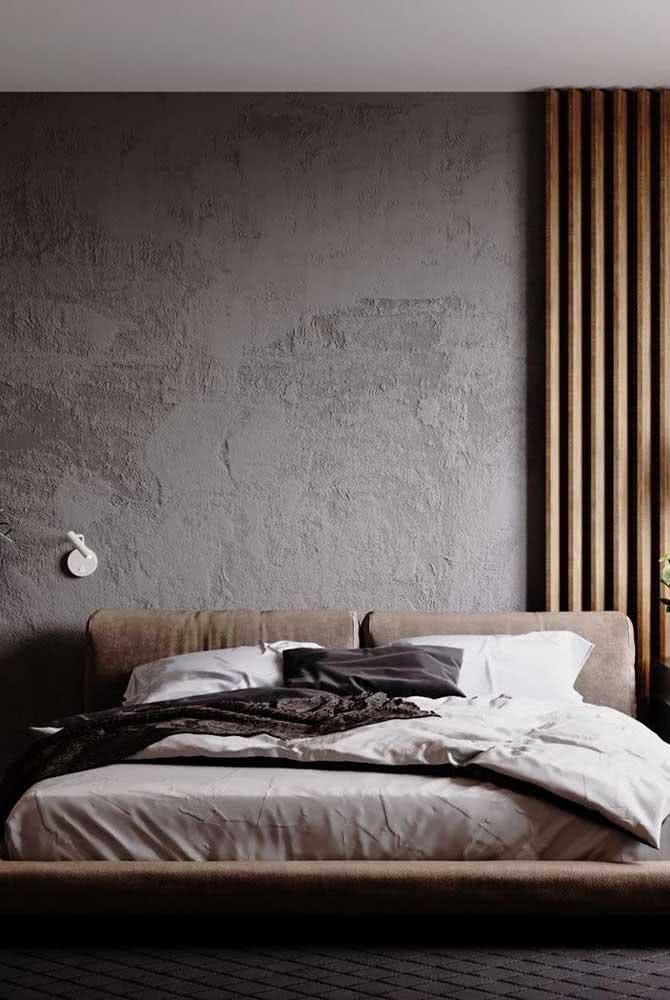 Quarto de casal aconchegante com textura de parede chapiscada na cor cinza.