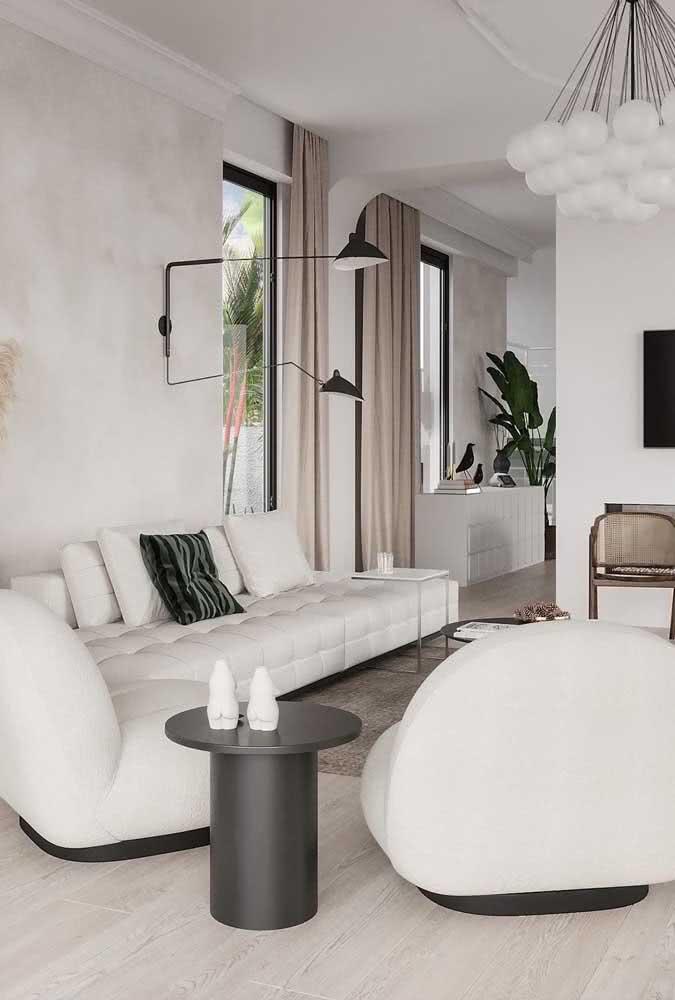 Sofá sem braço branco complementando o projeto dessa sala moderna e elegante