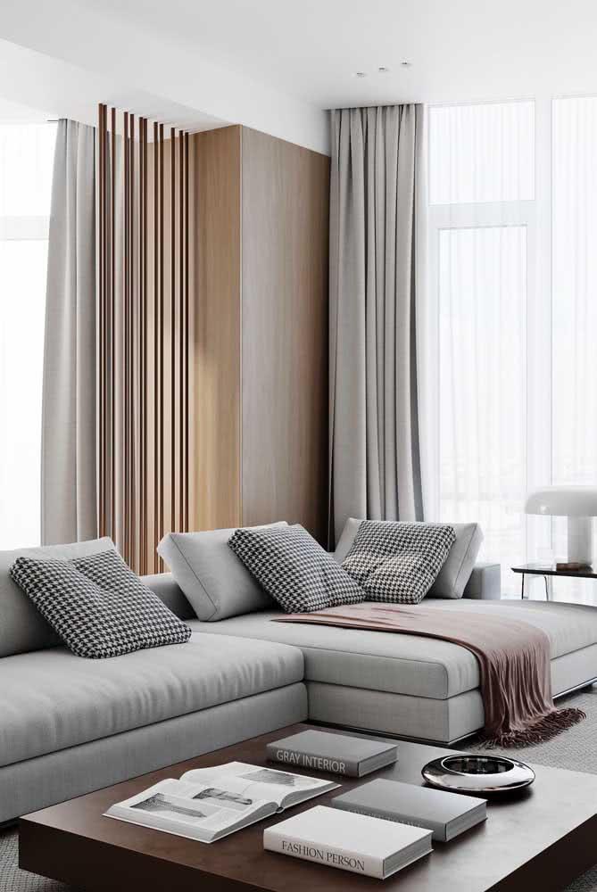 Valorize o seu sofá sem braço com mantas e almofadas