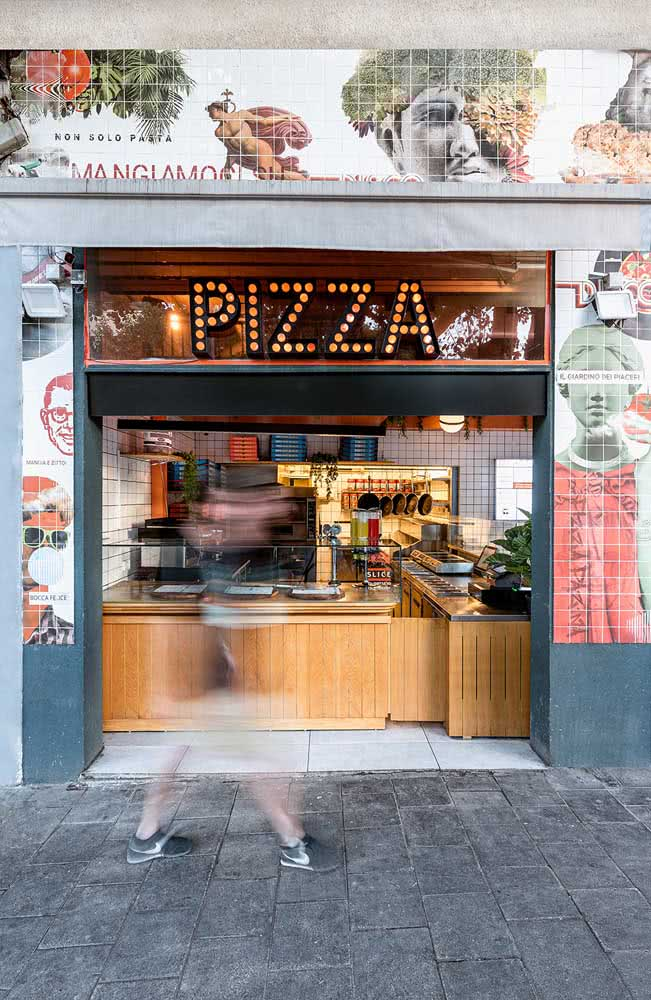 Fachada de pizzaria tem cor, textura e luz
