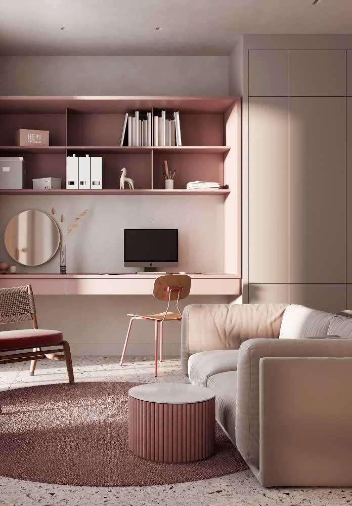 Sala e home office compartilhados e integrados pelo sofá de dois lugares