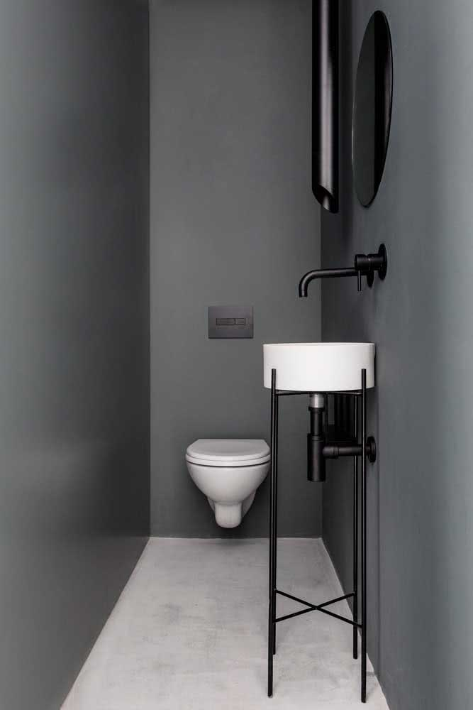 Lavabo pequeno e super moderno com paredes pintadas de cinza chumbo