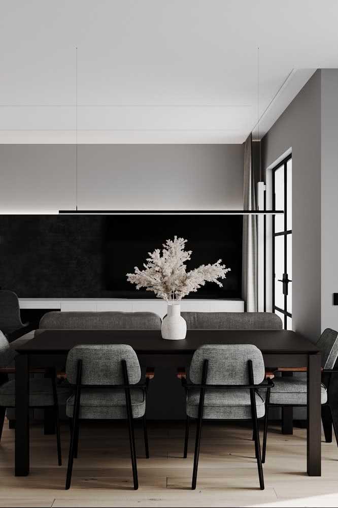 Sala de jantar moderna e sofisticada decorada em tons de cinza