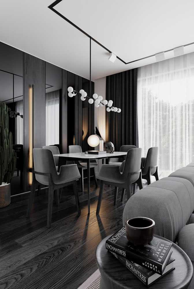 Sala de estar e jantar integradas pela cor cinza chumbo