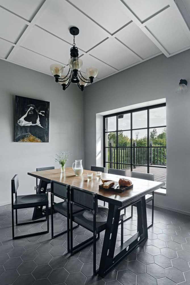 Sala de jantar moderna com mesa retangular industrial