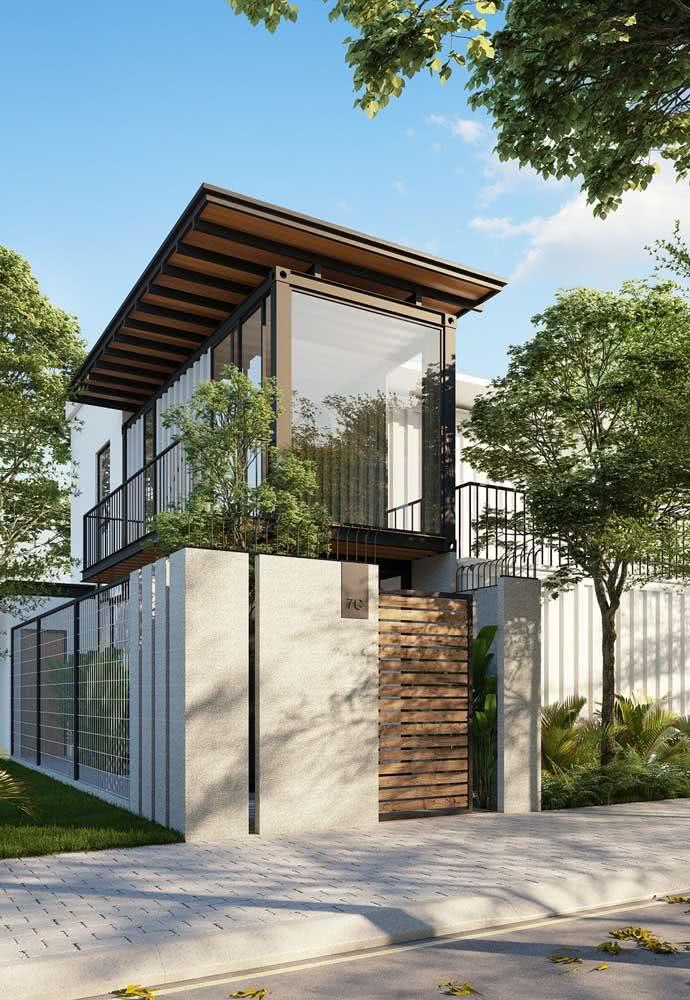 Essa fachada moderna traz um telhado bem diferente dos convencionais