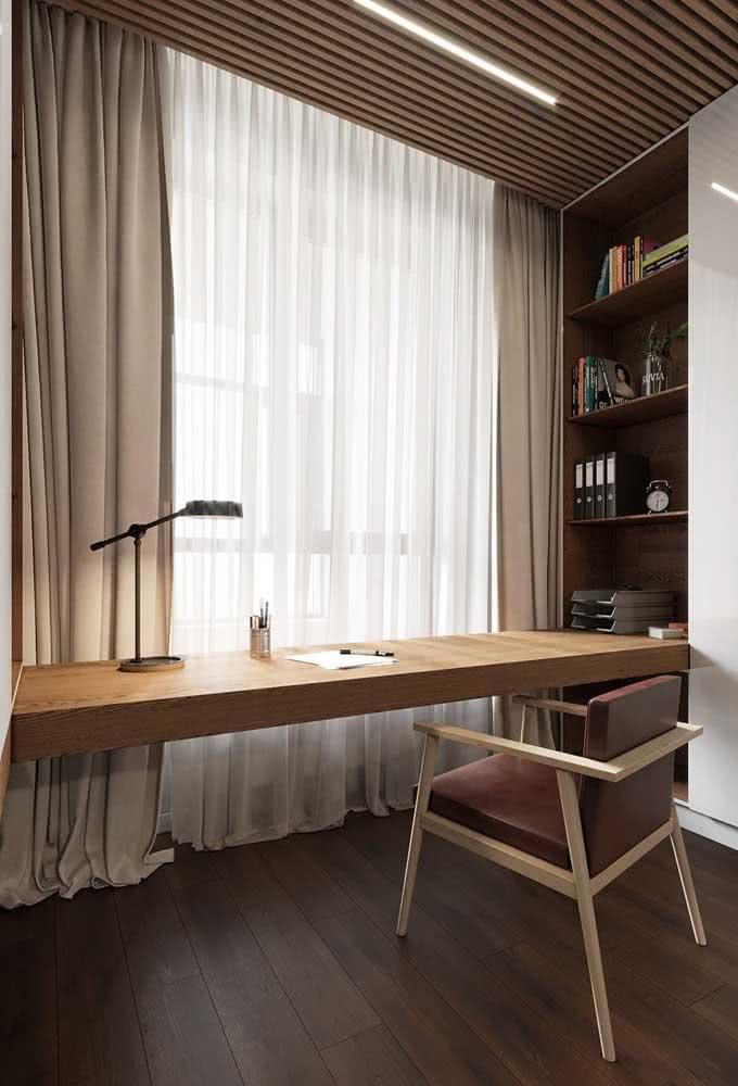 Aproveite a parede da janela para instalar a bancada suspensa do quarto
