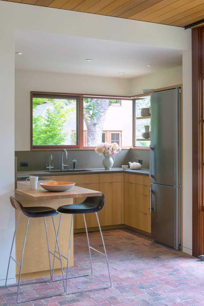 Cozinha sob medida em L com toque rústico na decoração
