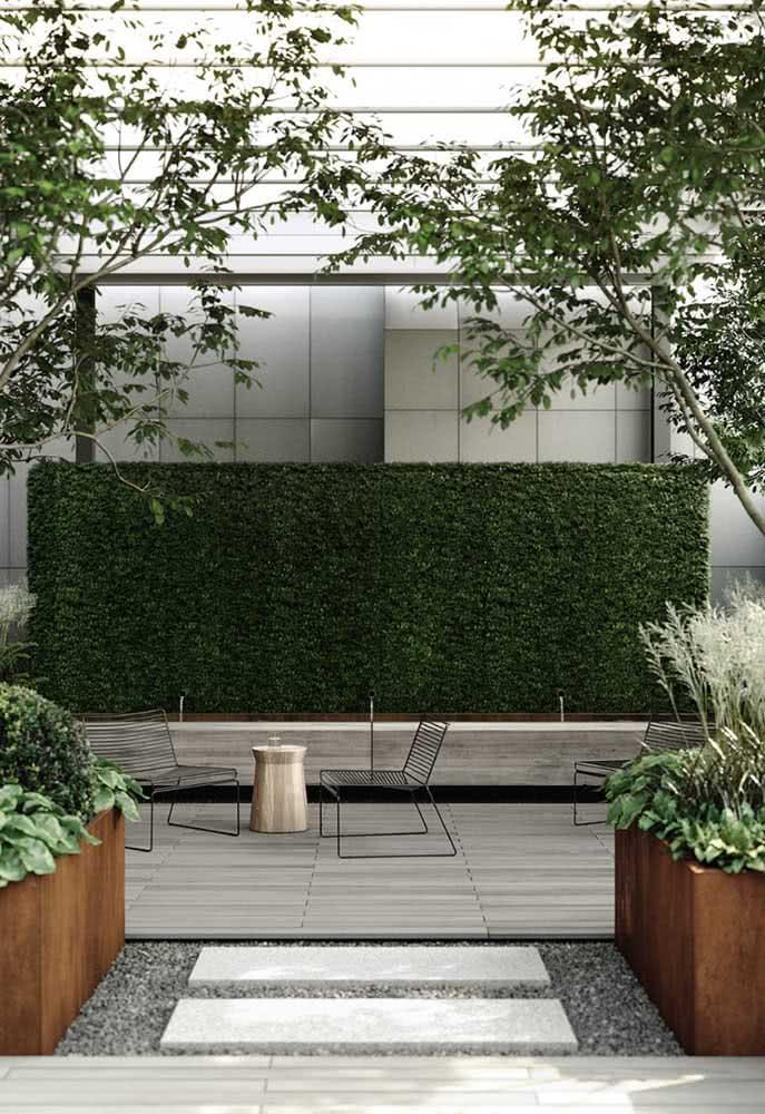 Área externa para espaço compartilhado elegante e com pedras no caminho.