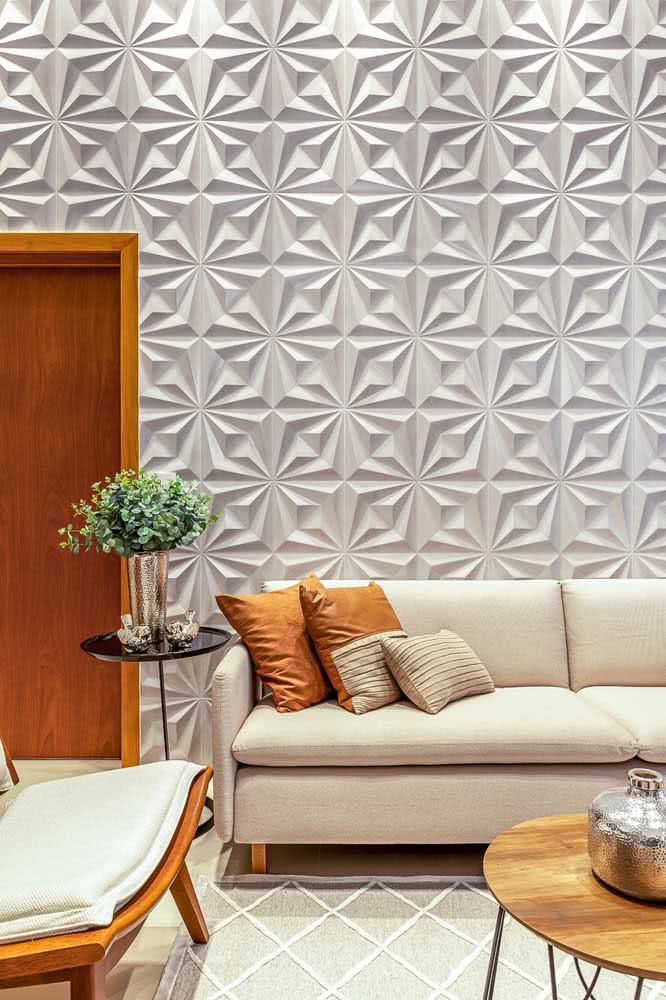 Revestimento de gesso 3D trazendo movimento para a decoração da sala