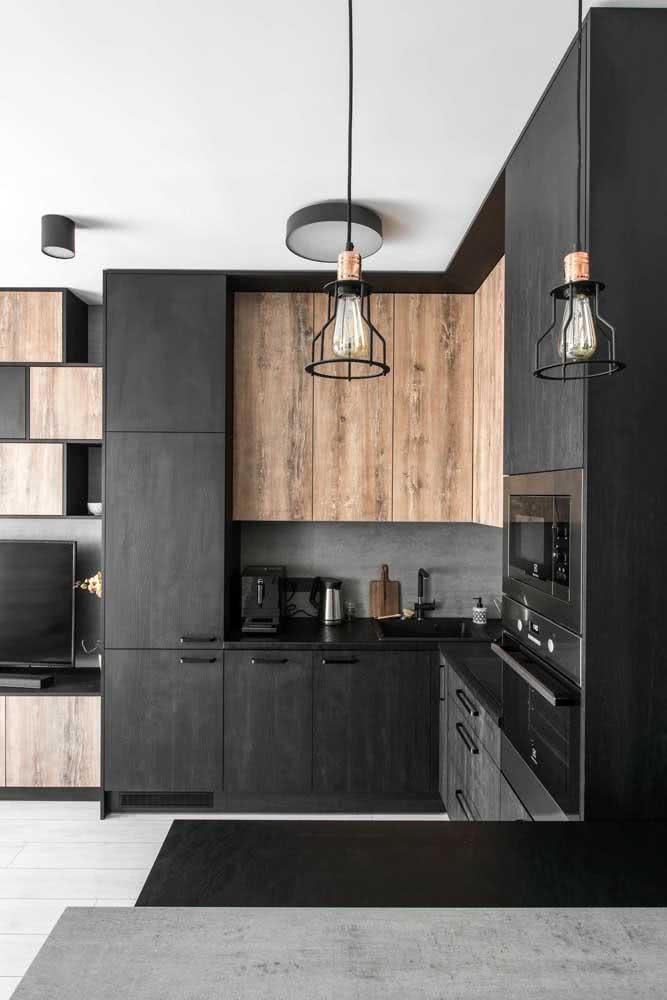 Forno e armários se confundem nessa cozinha moderna