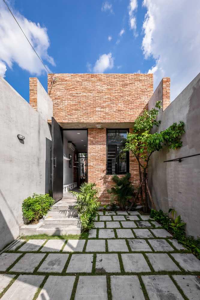 Projeto de casa rústica com tijolinhos na fachada