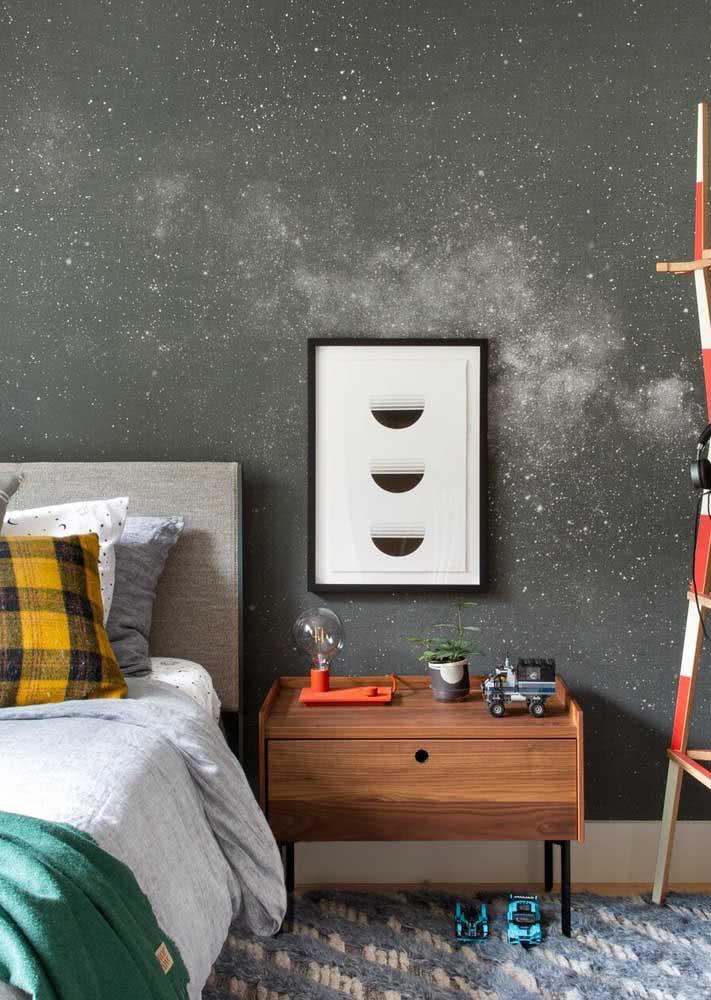 O universo como tema do papel de parede para quarto de criança