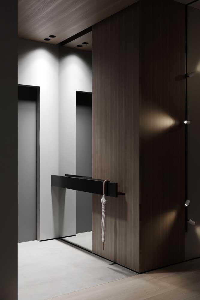 Que tal um projeto de hall de entrada pequeno moderno e minimalista?