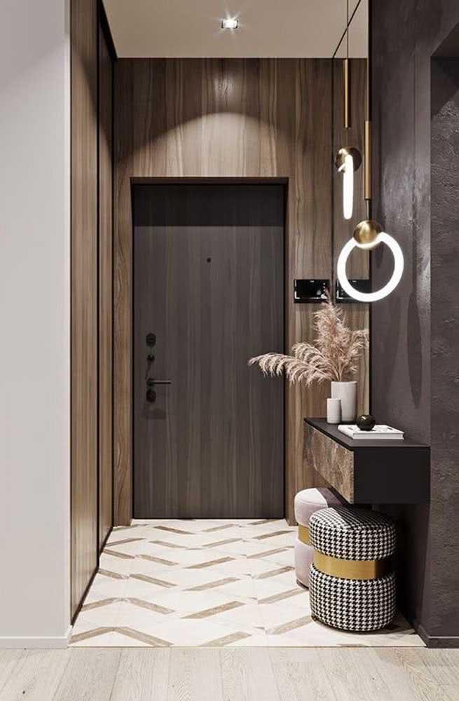 Hall de entrada pequeno e moderno decorado com aparador suspenso