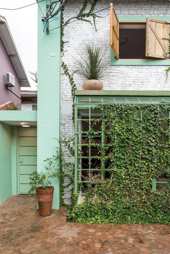 Verde menta e branco para a fachada da casa moderna