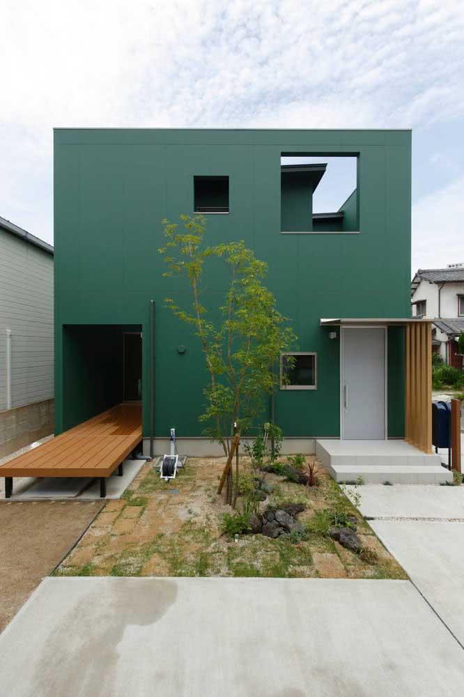 Um tom neutro e sóbrio de verde para valorizar a arquitetura moderna da casa