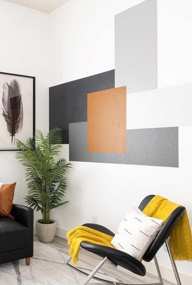 A sobreposição das formas simula uma pintura geométrica 3D na parede