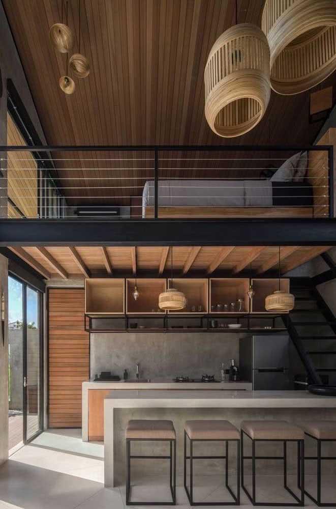 Loft industrial aconchegante graças ao uso da madeira e das fibras naturais