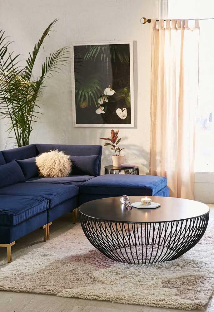 Uma super mesa de centro redonda para destacar a decoração moderna